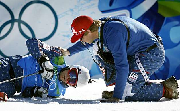 A team official checks on Daron Rahlves of the United States after Rahlves was eliminated from the men's ski cross competition at the Winter Olympic Games in West Vancouver, British Columbia, on Sunday.A team official checks on Daron Rahlves of the United States after Rahlves was eliminated from the men's ski cross competition at the Winter Olympic Games in West Vancouver, British Columbia, on Sunday, Feb. 21, 2010. Photo: Paul Chinn, The Chronicle