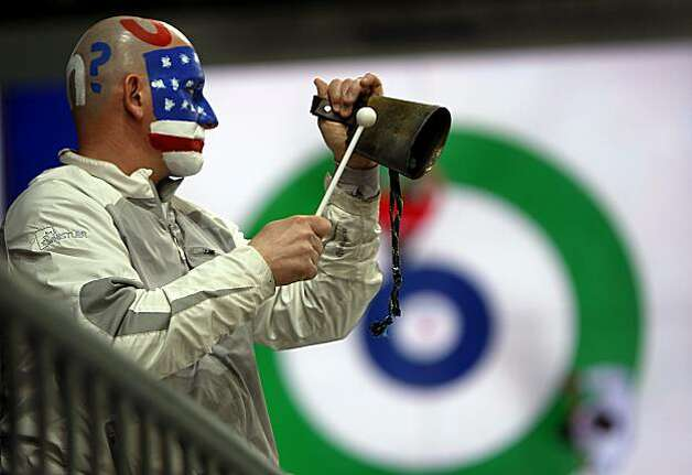 Patrick Plys rings a cowbell to cheer on his son Chris of the United States curling team during a match against France at the Winter Olympic Games in Vancouver, British Columbia, on Friday, Feb. 19, 2010. The United States beat France 4-3.Patrick Plys rings a cowbell to cheer on his son Chris of the United States curling team during a match against France at the Winter Olympic Games in Vancouver, British Columbia, on Friday, Feb. 19, 2010. The United States beat France 4-3. Photo: Paul Chinn, The Chronicle