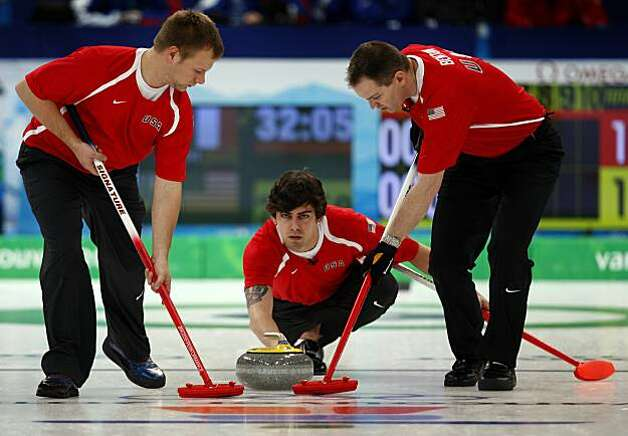 Jeff Isaacson (left), Chris Plys (center) and John Benton of the United States curling team delivers a stone in a curling match against France at the Winter Olympic Games in Vancouver, British Columbia, on Friday, Feb. 19, 2010. The United States beat FrJeff Isaacson (left), Chris Plys (center) and John Benton of the United States curling team delivers a stone in a curling match against France at the Winter Olympic Games in Vancouver, British Columbia, on Friday, Feb. 19, 2010. The United States beat France 4-3. Photo: Paul Chinn, The Chronicle