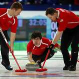 Jeff Isaacson (left), Chris Plys (center) and John Benton of the United States curling team delivers a stone in a curling match against France at the Winter Olympic Games in Vancouver, British Columbia, on Friday, Feb. 19, 2010. The United States beat FrJeff Isaacson (left), Chris Plys (center) and John Benton of the United States curling team delivers a stone in a curling match against France at the Winter Olympic Games in Vancouver, British Columbia, on Friday, Feb. 19, 2010. The United States beat France 4-3.