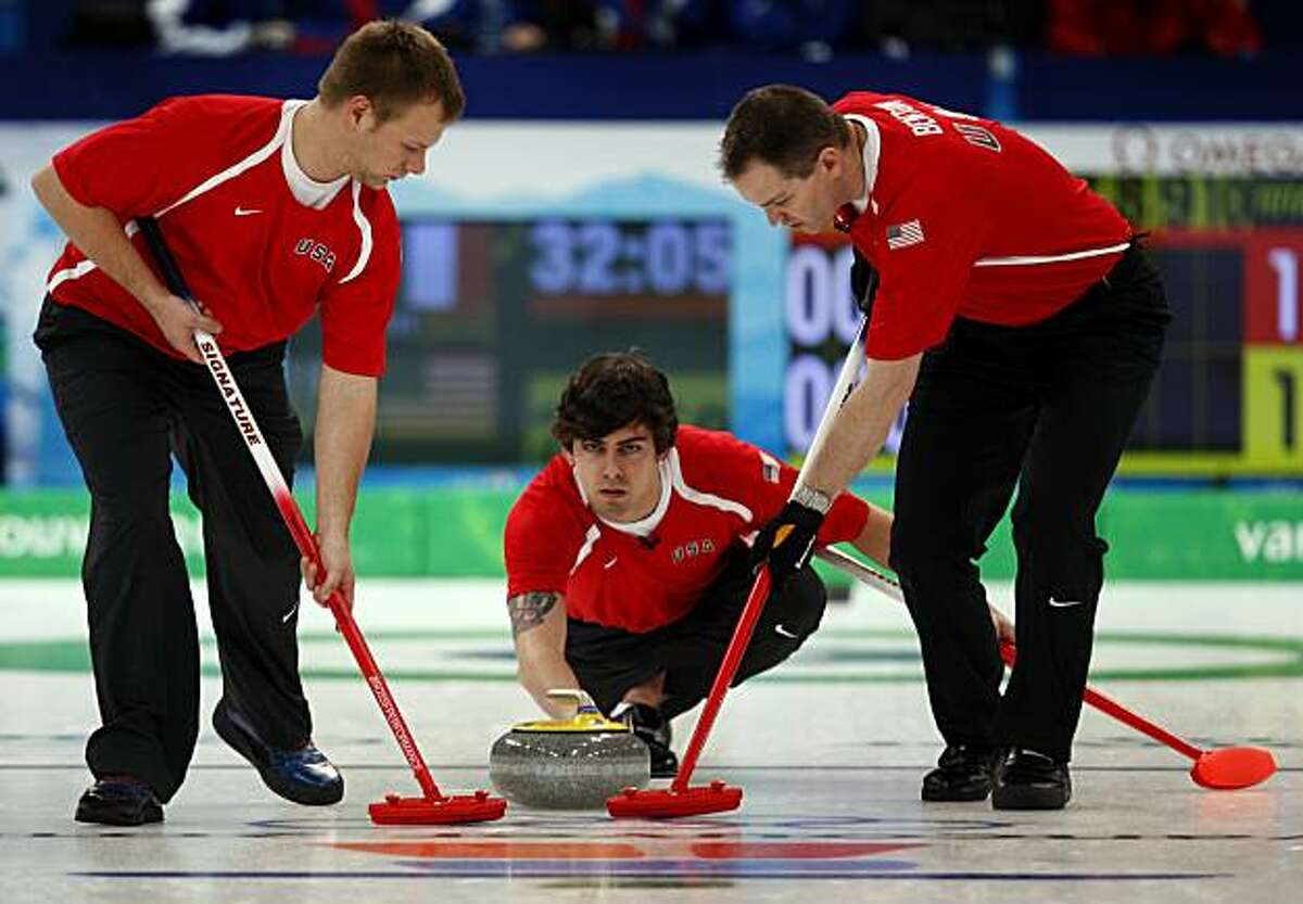 Men's curling was included in the Olympic program in 1924 at the first Olympic Winter Games in Chamonix. It was dropped, then later reintroduced as a demonstration sport in 1932 in Lake Placid. Here, from left, Jeff Isaacson, Chris Plys and John Benton play in 2010 for the United States in Vancouver, British Columbia.