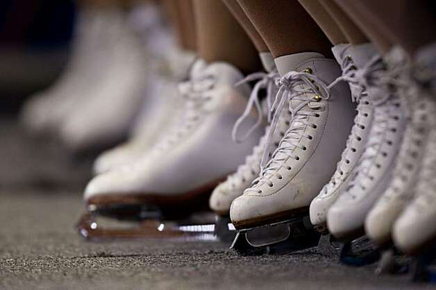 The skates of rink volunteers are seen while Kamila Hajova and  David Vicour of the Czech Republic perform during the ice dancing free skate at the 2010 Winter Olympics on Monday, Feb. 22, 2010, in Vancouver. ( Smiley N. Pool / Houston Chronicle)The skates of rink volunteers are seen while Kamila Hajova and  David Vicour of the Czech Republic perform during the ice dancing free skate at the 2010 Winter Olympics on Monday, Feb. 22, 2010, in Vancouver. Photo: Smiley N. Pool, Chronicle Olympic Bureau