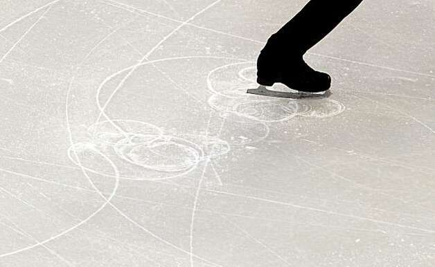 Viktor Pfeifer of Austria cuts a pattern in the ice as he performs his short program during men's figure skating at the 2010 Winter Olympics on Tuesday, Feb. 16, 2010, in Vancouver. ( Smiley N. Pool / Houston Chronicle )Viktor Pfeifer of Austria cuts a pattern in the ice as he performs his short program during men's figure skating at the 2010 Winter Olympics on Tuesday, Feb. 16, 2010, in Vancouver. Photo: Smiley N. Pool, Chronicle Olympic Bureau