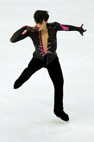 Johnny Weir of the USA performs his short program during men's figure skating at the 2010 Winter Olympics on Tuesday, Feb. 16, 2010, in Vancouver. ( Smiley N. Pool / Houston Chronicle )Johnny Weir of the USA performs his short program during men's figure skating at the 2010 Winter Olympics on Tuesday, Feb. 16, 2010, in Vancouver. Photo: Smiley N. Pool, Chronicle Olympic Bureau