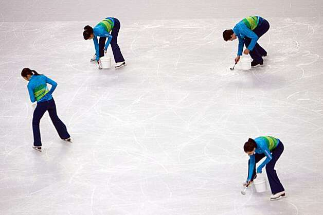 Workers prepare the ice for resurfacing between groups during short program during men's figure skating at the 2010 Winter Olympics on Tuesday, Feb. 16, 2010, in Vancouver. ( Smiley N. Pool / Houston Chronicle )Workers prepare the ice for resurfacing between groups during short program during men's figure skating at the 2010 Winter Olympics on Tuesday, Feb. 16, 2010, in Vancouver. Photo: Smiley N. Pool, Chronicle Olympic Bureau