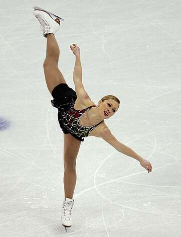 Joannie Rochette of Canada skates in the short program of the women's figure skating competition in Vancouver, British Columbia, on Tuesday. Rochette's mother died of a heart attack Sunday, one day after arriving in town to watch Rochette compete in theJoannie Rochette of Canada skates in the short program of the women's figure skating competition in Vancouver, British Columbia, on Tuesday, Feb. 23, 2010. Rochette's mother died of a heart attack on Sunday one day after arriving in town to watch Joannie compete in the Olympics. Photo: Paul Chinn, The Chronicle