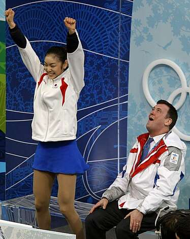 Yu-Na Kim of the Republic of Korea and her coach Brian Orser celebrate her winning score in the free program of the women's figure skating competition at the Winter Olympic Games in Vancouver, British Columbia, on Thursday, Feb. 25, 2010. Paul Chinn/ChroYu-Na Kim of the Republic of Korea and her coach Brian Orser celebrate her winning score in the free program of the women's figure skating competition at the Winter Olympic Games in Vancouver, British Columbia, on Thursday, Feb. 25, 2010. Photo: Paul Chinn, The Chronicle