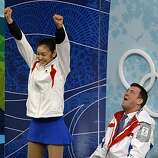 Yu-Na Kim of the Republic of Korea and her coach Brian Orser celebrate her winning score in the free program of the women's figure skating competition at the Winter Olympic Games in Vancouver, British Columbia, on Thursday, Feb. 25, 2010. Paul Chinn/ChroYu-Na Kim of the Republic of Korea and her coach Brian Orser celebrate her winning score in the free program of the women's figure skating competition at the Winter Olympic Games in Vancouver, British Columbia, on Thursday, Feb. 25, 2010.