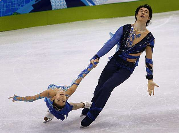 Qing Pang, and Jian Tong of China perform their short program in the pairs skating competition at the Winter Olympic Games in Vancouver, B.C., on Sunday.Qing Pang (left) and Jian Tong of China perform their short program in the pairs skating competition at the Winter Olympic Games in Vancouver, B.C., on Saturday, Feb. 13, 2010. Pang and Tong are in fourth place heading into the long program. Photo: Paul Chinn, The Chronicle