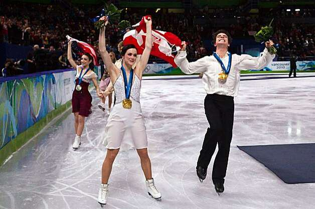 Tessa Virtue and Scott Moir of Canada celebrate with Meryl Davis and Chalie White of the USA after winning the gold and silver medals, respectively, the ice dancing free skate at the 2010 Winter Olympics on Monday, Feb. 22, 2010, in Vancouver. ( Smiley N.Tessa Virtue and Scott Moir of Canada celebrate with Meryl Davis and Chalie White of the USA after winning the gold and silver medals, respectively, the ice dancing free skate at the 2010 Winter Olympics on Monday, Feb. 22, 2010, in Vancouver. Photo: Smiley N. Pool, Chronicle Olympic Bureau