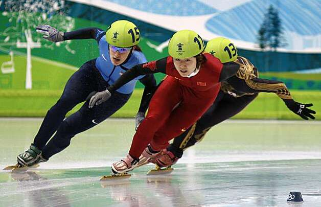 Katherine Reutter (left) of the United States maneuvers around China's Linlin Sun to advance in the 1000-meter race of the short track speed skating competition at the Winter Olympic Games in Vancouver, British Columbia, on Wednesday, Feb. 24, 2010. PaulKatherine Reutter (left) of the United States maneuvers around China's Linlin Sun to advance in the 1000-meter race of the short track speed skating competition at the Winter Olympic Games in Vancouver, British Columbia, on Wednesday, Feb. 24, 2010. Photo: Paul Chinn, The Chronicle