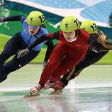 Katherine Reutter (left) of the United States maneuvers around China's Linlin Sun to advance in the 1000-meter race of the short track speed skating competition at the Winter Olympic Games in Vancouver, British Columbia, on Wednesday, Feb. 24, 2010. PaulKatherine Reutter (left) of the United States maneuvers around China's Linlin Sun to advance in the 1000-meter race of the short track speed skating competition at the Winter Olympic Games in Vancouver, British Columbia, on Wednesday, Feb. 24, 2010.