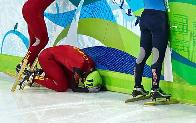 Yang Zhou of China reacts after being disqualified in the women's 1000 meters in short track speedskating at the 2010 Winter Olympics on Friday, Feb. 26, 2010, in Vancouver.  ( Smiley N. Pool / Houston Chronicle)Yang Zhou of China reacts after being disqualified in the women's 1000 meters in short track speedskating at the 2010 Winter Olympics on Friday, Feb. 26, 2010, in Vancouver. Photo: Smiley N. Pool, Chronicle Olympic Bureau