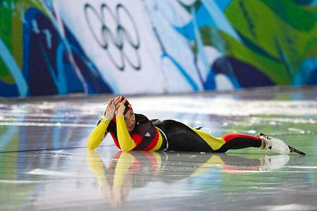 Anna Friesinger-Postma of Germany reacts after sliding across the finish line to give Germany the win over the USA in the women's team pursuit speed skating semifinals at the 2010 Winter Olympics on Saturday, Feb. 27, 2010, in Vancouver. ( Smiley N. PoolAnna Friesinger-Postma of Germany reacts after sliding across the finish line to give Germany the win over the USA in the women's team pursuit speed skating semifinals at the 2010 Winter Olympics on Saturday, Feb. 27, 2010, in Vancouver. Photo: Smiley N. Pool, Chronicle Olympic Bureau