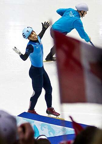 USA's Apolo Anton Ohno (256) gestures to the crowd after he was disqualified from the men's 500 meter finals in short track speed skating at the 2010 Winter Olympics on Friday, Feb. 26, 2010, in Vancouver.  ( Smiley N. Pool / Houston Chronicle)USA's Apolo Anton Ohno (256) gestures to the crowd after he was disqualified from the men's 500 meter finals in short track speed skating at the 2010 Winter Olympics on Friday, Feb. 26, 2010, in Vancouver. Photo: Smiley N. Pool, Chronicle Olympic Bureau