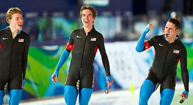 Chad Hedrick of the USA, right, celebrates with Brian Hansen, left, and Jonathan Kuck, center, after an upset win over the Netherlands during the men's speed skating team pursuit semi finals at the 2010 Winter Olympics on Friday, Feb. 26, 2010, in VancouvChad Hedrick of the USA, right, celebrates with Brian Hansen, left, and Jonathan Kuck, center, after an upset win over the Netherlands during the men's speed skating team pursuit semi finals at the 2010 Winter Olympics on Friday, Feb. 26, 2010, in Vancouver.  The USA will now skate for the gold medal on Saturday. Photo: Smiley N. Pool, Chronicle Olympic Bureau