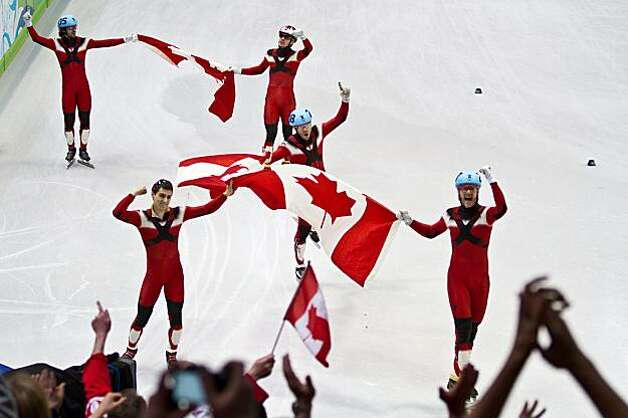 Team Canada celebrates winning the men's 5000 meter relay in short track speedskating at the 2010 Winter Olympics on Friday, Feb. 26, 2010, in Vancouver.  Canada took the gold.  Korea took the silver.  The USA won bronze, giving USA's Apolo Anton Ohno hisTeam Canada celebrates winning the men's 5000 meter relay in short track speedskating at the 2010 Winter Olympics on Friday, Feb. 26, 2010, in Vancouver.  Canada took the gold.  Korea took the silver.  The USA won bronze, giving USA's Apolo Anton Ohno his record eighth Olympic medal. Photo: Smiley N. Pool, Chronicle Olympic Bureau