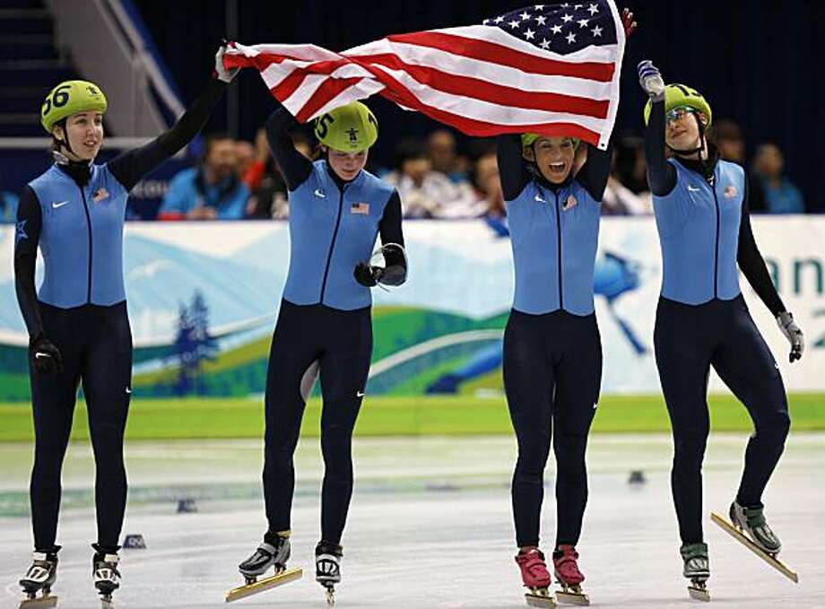 Team United States celebrates its surprise bronze medal win after the team from the Republic of Korea were disqualified from the finals of the women's 3000 meter relay of the short track speed skating competition at the Winter Olympic Games in Vancouver,Team United States celebrates its surprise bronze medal win after the team from the Republic of Korea were disqualified from the finals of the women's 3000 meter relay of the short track speed skating competition at the Winter Olympic Games in Vancouver, British Columbia, on Wednesday, Feb. 24, 2010. Photo: Paul Chinn, The Chronicle
