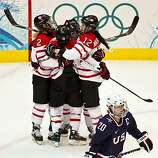USA's Natalie Darwitz (20) skates away as Team Canada players celebrate a first period goal by Canada's Marie-Philip Poulin in the women's gold medal hockey game at the 2010 Winter Olympics on Thursday, Feb. 25, 2010, in Vancouver.  ( Smiley N. Pool / HoUSA's Natalie Darwitz (20) skates away as Team Canada players celebrate a first period goal by Canada's Marie-Philip Poulin in the women's gold medal hockey game at the 2010 Winter Olympics on Thursday, Feb. 25, 2010, in Vancouver.