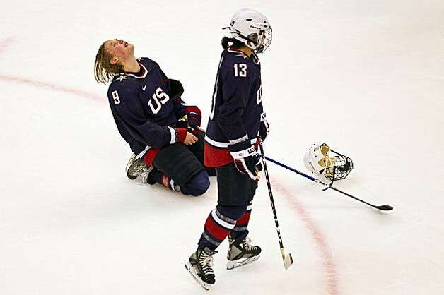 USA's Molly Engstrom (9) and Julie Chu (13) react after the USA lost to Canada in the women's gold medal hockey game at the 2010 Winter Olympics on Thursday, Feb. 25, 2010, in Vancouver.  ( Smiley N. Pool / Houston Chronicle)USA's Molly Engstrom (9) and Julie Chu (13) react after the USA lost to Canada in the women's gold medal hockey game at the 2010 Winter Olympics on Thursday, Feb. 25, 2010, in Vancouver. Photo: Smiley N. Pool, Chronicle Olympic Bureau
