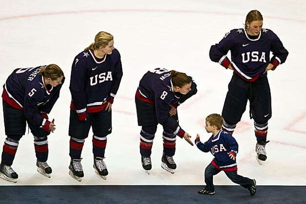 Jenny Potter's son Cullen high fives USA players, from left Karen Thatcher (5), Monique Lamoureux (7), Caitlin Cahow (8) and Molly Engstrom (9) after the USA lost to Canada in the women's gold medal hockey game at the 2010 Winter Olympics on Thursday, FebJenny Potter's son Cullen high fives USA players, from left Karen Thatcher (5), Monique Lamoureux (7), Caitlin Cahow (8) and Molly Engstrom (9) after the USA lost to Canada in the women's gold medal hockey game at the 2010 Winter Olympics on Thursday, Feb. 25, 2010, in Vancouver. Photo: Smiley N. Pool, Chronicle Olympic Bureau