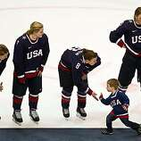 Jenny Potter's son Cullen high fives USA players, from left Karen Thatcher (5), Monique Lamoureux (7), Caitlin Cahow (8) and Molly Engstrom (9) after the USA lost to Canada in the women's gold medal hockey game at the 2010 Winter Olympics on Thursday, FebJenny Potter's son Cullen high fives USA players, from left Karen Thatcher (5), Monique Lamoureux (7), Caitlin Cahow (8) and Molly Engstrom (9) after the USA lost to Canada in the women's gold medal hockey game at the 2010 Winter Olympics on Thursday, Feb. 25, 2010, in Vancouver.