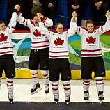 Canada players before receiving their medals after beating the USA in the women's gold medal hockey game at the 2010 Winter Olympics on Thursday, Feb. 25, 2010, in Vancouver.  ( Smiley N. Pool / Houston Chronicle)Canada players before receiving their medals after beating the USA in the women's gold medal hockey game at the 2010 Winter Olympics on Thursday, Feb. 25, 2010, in Vancouver.
