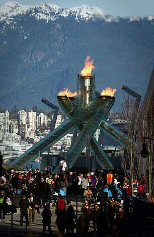 Crowds visit the Olympic cauldron in downtown Vancouver at the 2010 Winter Olympics on Wednesday, Feb. 17, 2010.  Complaints about the inability to see the cauldron because of fencing prompted officials to open a viewing area and remove banners from theCrowds visit the Olympic cauldron in downtown Vancouver at the 2010 Winter Olympics on Wednesday, Feb. 17, 2010.  Complaints about the inability to see the cauldron because of fencing prompted officials to open a viewing area and remove banners from the fences.  The line for the viewing area was 45 minutes long. Photo: Smiley N. Pool, Chronicle Olympic Bureau