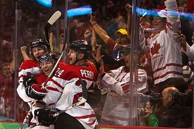 Canada's Corey Perry (24) celebrates with teammates after scoring in the second period Canada's 7-3 victory over Russia in men's hockey quarterfinal action at the 2010 Winter Olympics on Wednesday, Feb. 24, 2010, in Vancouver.  ( Smiley N. Pool / HoustonCanada's Corey Perry (24) celebrates with teammates after scoring in the second period Canada's 7-3 victory over Russia in men's hockey quarterfinal action at the 2010 Winter Olympics on Wednesday, Feb. 24, 2010, in Vancouver. Photo: Smiley N. Pool, Chronicle Olympic Bureau