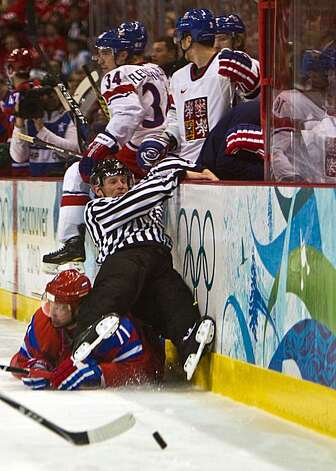 A linesman is taken down in a collision with Russia's Ilya Kovalchuk in men's hockey preliminary round action against the Czech Republic at the 2010 Winter Olympics on Sunday, Feb. 21, 2010, in Vancouver. ( Smiley N. Pool / Houston Chronicle)A linesman is taken down in a collision with Russia's Ilya Kovalchuk in men's hockey preliminary round action against the Czech Republic at the 2010 Winter Olympics on Sunday, Feb. 21, 2010, in Vancouver. Photo: Smiley N. Pool, Chronicle Olympic Bureau