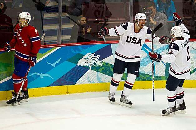 USA's Ryan Malone (12) celebrates with teammate Jack Johnson (3)after scoring a third period goal against Norway in a preliminary round hockey game at the 2010 Winter Olympics on Thursday, Feb. 18, 2010, in Vancouver.  The USA won the game 6-1. ( Smiley NUSA's Ryan Malone (12) celebrates with teammate Jack Johnson (3)after scoring a third period goal against Norway in a preliminary round hockey game at the 2010 Winter Olympics on Thursday, Feb. 18, 2010, in Vancouver.  The USA won the game 6-1. Photo: Smiley N. Pool, Chronicle Olympic Bureau
