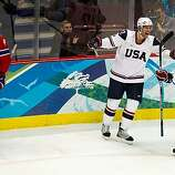 USA's Ryan Malone (12) celebrates with teammate Jack Johnson (3)after scoring a third period goal against Norway in a preliminary round hockey game at the 2010 Winter Olympics on Thursday, Feb. 18, 2010, in Vancouver.  The USA won the game 6-1. ( Smiley NUSA's Ryan Malone (12) celebrates with teammate Jack Johnson (3)after scoring a third period goal against Norway in a preliminary round hockey game at the 2010 Winter Olympics on Thursday, Feb. 18, 2010, in Vancouver.  The USA won the game 6-1.