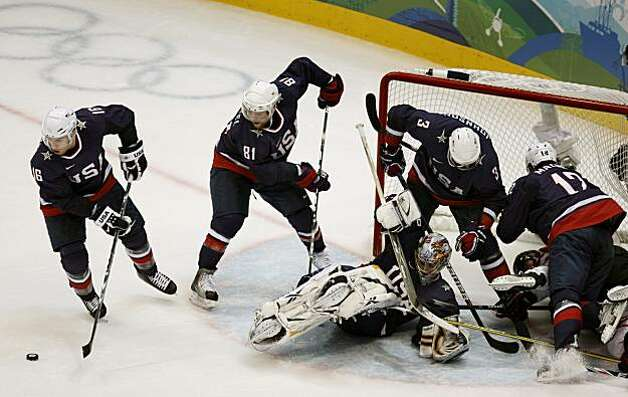 USA's Joe Pavelski (16) clears the puck away from the net in the second period of the gold medal hockey game against Canada at the Winter Olympic Games in Vancouver, British Columbia, on Sunday, Feb. 28, 2010. Paul Chinn/Chronicle Olympic BureauUSA's Joe Pavelski (16) clears the puck away from the net in the second period of the gold medal hockey game against Canada at the Winter Olympic Games in Vancouver, British Columbia, on Sunday, Feb. 28, 2010. Photo: Paul Chinn, The Chronicle