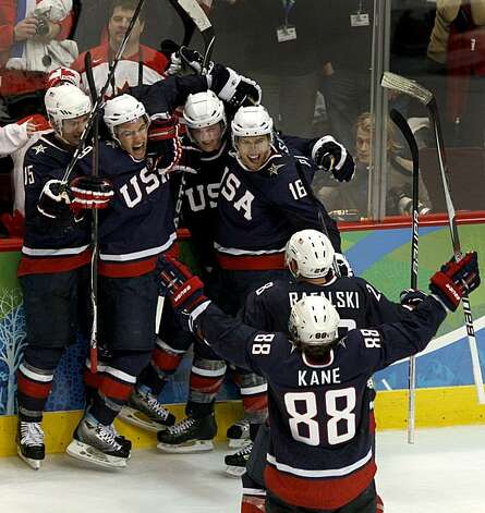 Team USA celebrates Zach Parise's (second from left) late in the third period against Canada which forced overtime in the gold medal hockey game at the Winter Olympic Games in Vancouver, British Columbia, on Sunday, Feb. 28, 2010. The celebration was shoTeam USA celebrates Zach Parise's (second from left) late in the third period against Canada which forced overtime in the gold medal hockey game at the Winter Olympic Games in Vancouver, British Columbia, on Sunday, Feb. 28, 2010. The celebration was short lived as Canada went on to capture the gold. Photo: Paul Chinn, The Chronicle