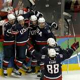 Team USA celebrates Zach Parise's (second from left) late in the third period against Canada which forced overtime in the gold medal hockey game at the Winter Olympic Games in Vancouver, British Columbia, on Sunday, Feb. 28, 2010. The celebration was shoTeam USA celebrates Zach Parise's (second from left) late in the third period against Canada which forced overtime in the gold medal hockey game at the Winter Olympic Games in Vancouver, British Columbia, on Sunday, Feb. 28, 2010. The celebration was short lived as Canada went on to capture the gold.