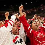 Canada, from left, Andy Hajak, Wolfgang Bauke and Hanif Nirani celebrate a goal in the first period Canada's 7-3 victory over Russia in men's hockey quarterfinal action at the 2010 Winter Olympics on Wednesday, Feb. 24, 2010, in Vancouver.  ( Smiley N. PoCanada, from left, Andy Hajak, Wolfgang Bauke and Hanif Nirani celebrate a goal in the first period Canada's 7-3 victory over Russia in men's hockey quarterfinal action at the 2010 Winter Olympics on Wednesday, Feb. 24, 2010, in Vancouver.