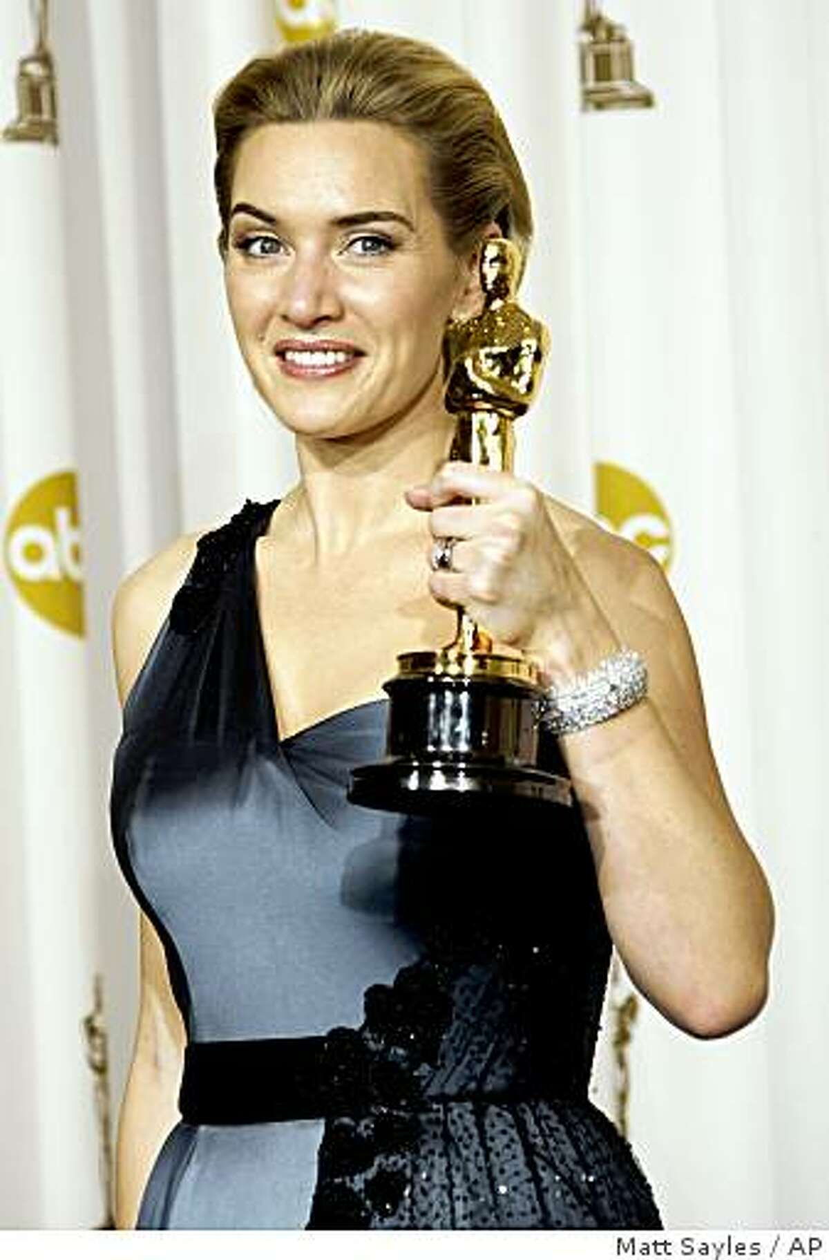 British actress Kate Winslet holds the Oscar for best actress for her work in
