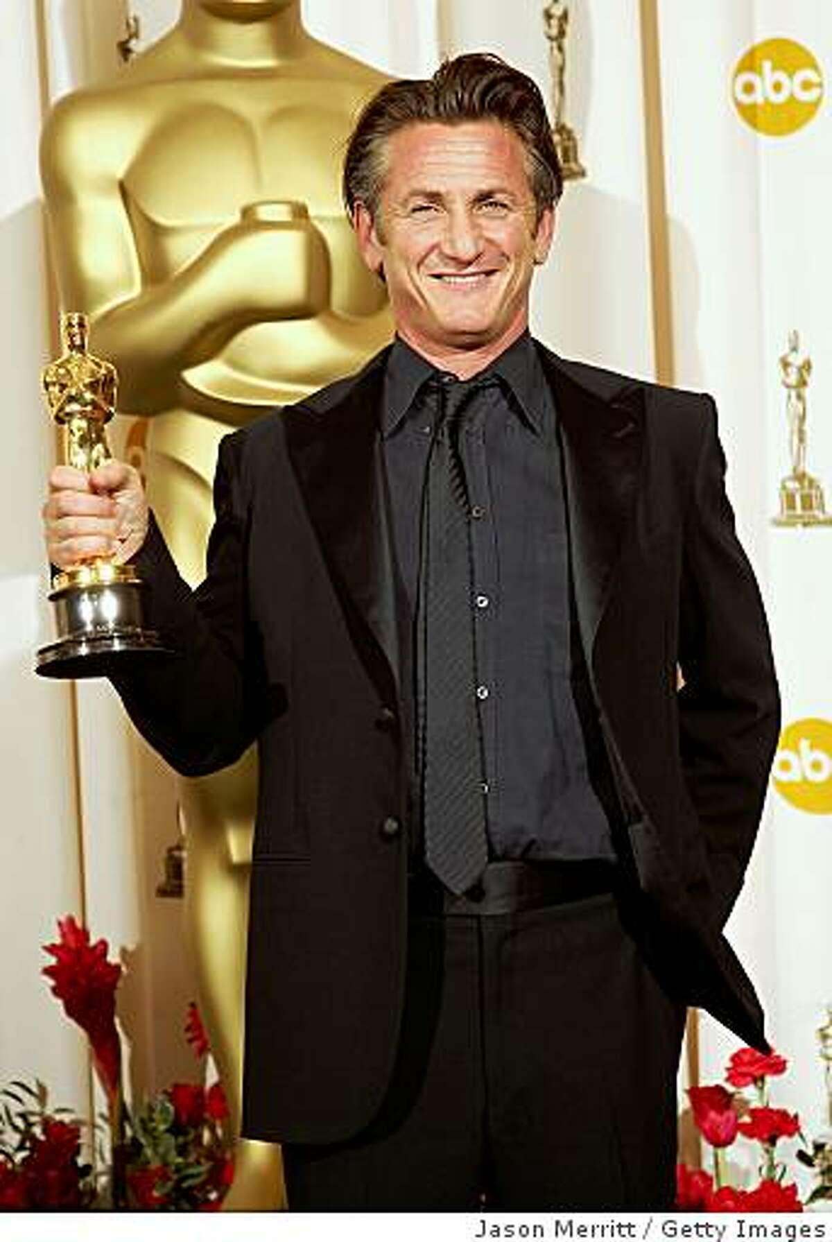Actor Sean Penn poses in the press room after winning the award for Best Actor for
