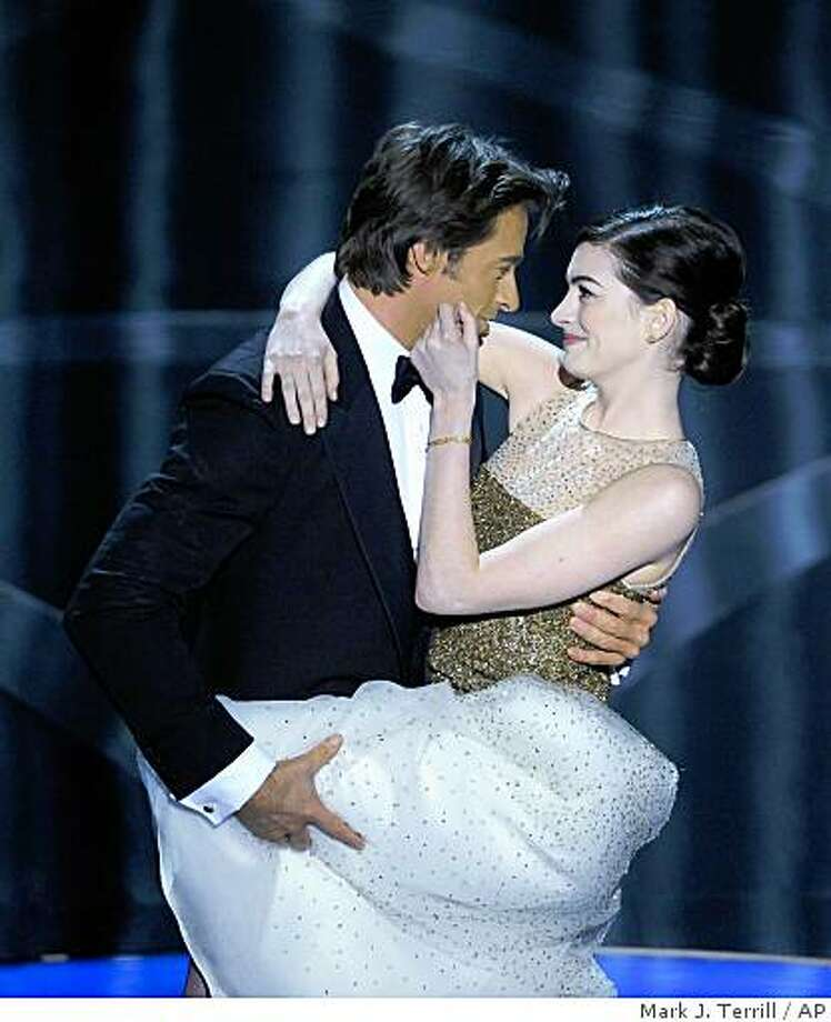 Oscar host Hugh Jackman performs a skit with actress Anne Hathaway during the 81st Academy Awards Sunday, Feb. 22, 2009, in the Hollywood section of Los Angeles. Photo: Mark J. Terrill, AP