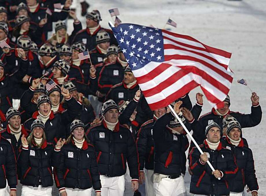 Luger Mark Grimmette carries the stars and stripes as he leads Team USA into BC Place stadium during the opening ceremony for the Winter Olympic Games in Vancouver, B.C., on Friday. Photo: Paul Chinn, The Chronicle