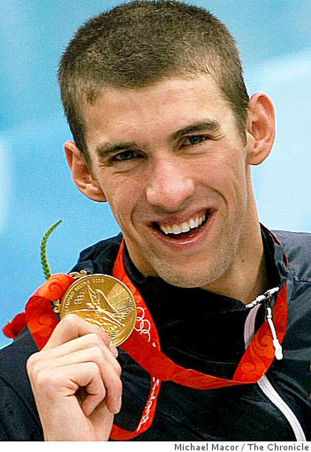 Michael Phelps holds up his 8th gold medal he won in Men's 4x100 Medley relay final on Sunday Aug. 17, 2008 at the Olympic Games in Beijing, China. Photo: Michael Macor, The Chronicle