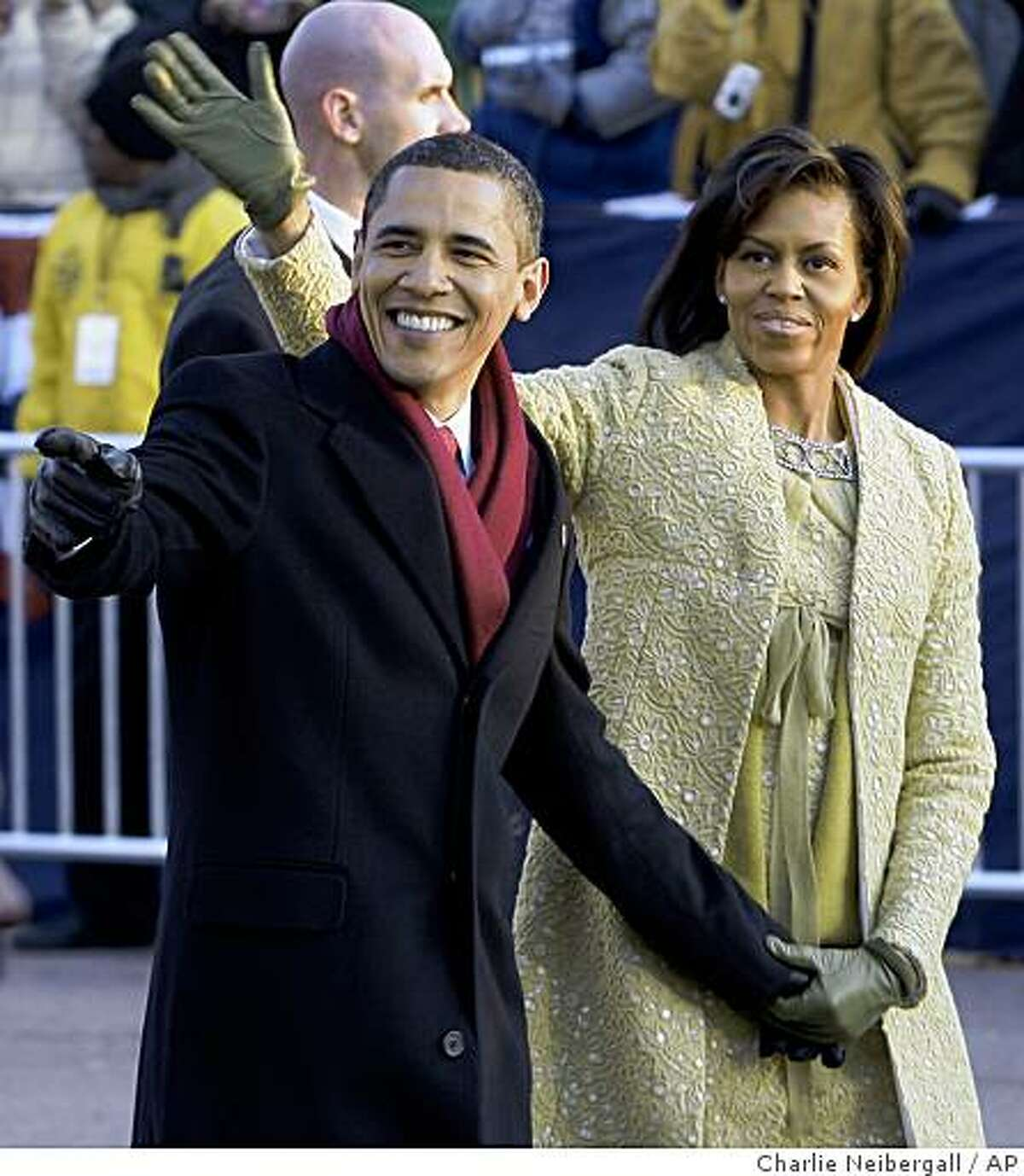 President Barack Obama and his wife Michelle walk on Pennsylvania Avenue near the White House in Washington, Tuesday, Jan. 20, 2009, during his inaugural parade.
