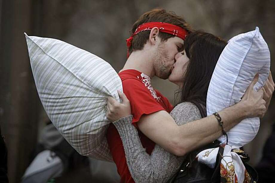 Julia Test and Mark Perdue both of San Francisco share a kiss before the Great San Francisco Pillow Fight in Justin Herman Plaza on Sunday February 14, 2010 in San Francisco, Calif. Photo: Lea Suzuki, The Chronicle