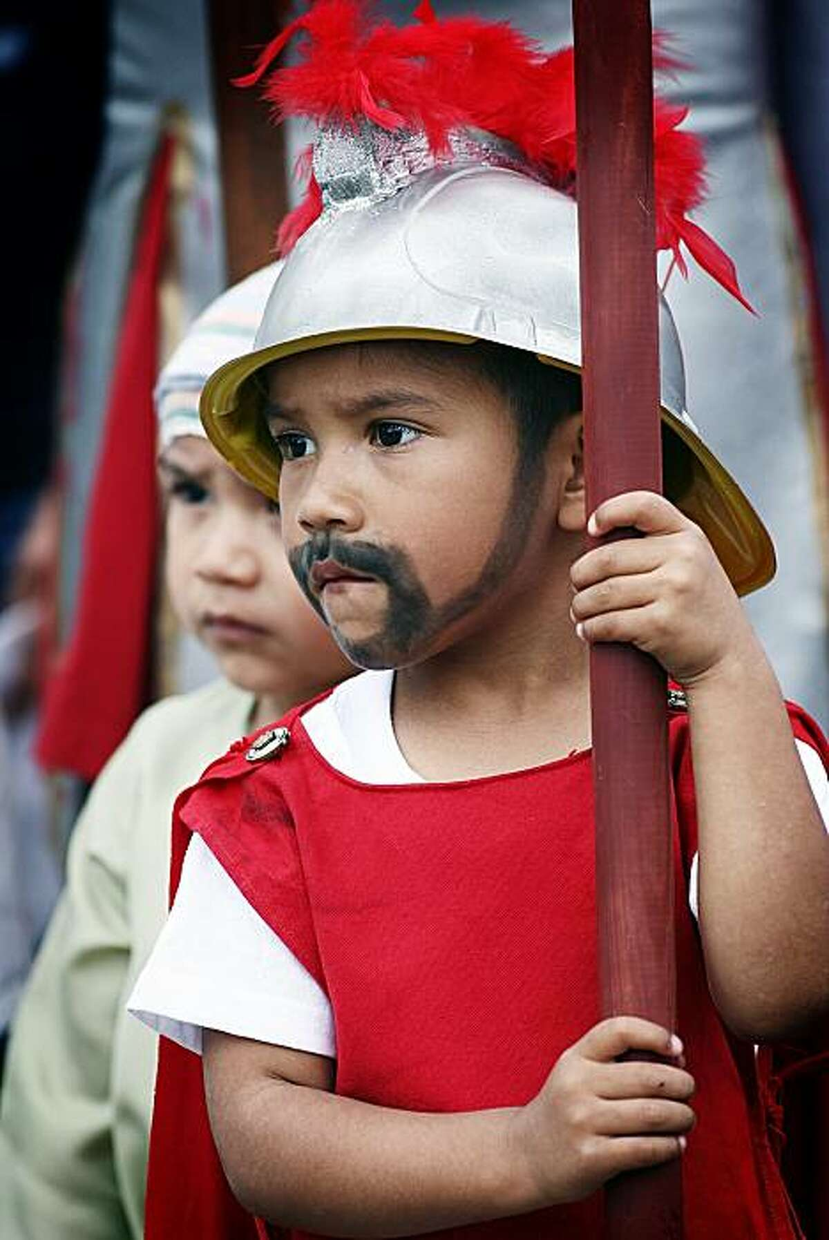 Three-year-old Gabriel Velazquez, with his face painted to depict a bearded Roman soldier, participates in a Passion play in Victoria, Texas for Good Friday, April 2, 2010. Santisima Trinidad's Church holds a Stations of the Cross every year on Good Friday and encourages the teens and kids of the parish to be involved in the production.