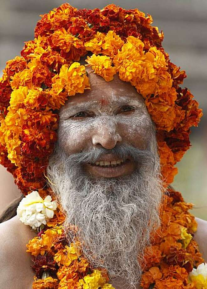 A naked Hindu holy man looks on as he takes part in a procession as part of monthslong Hindu festival Kumbh Mela, in Haridwar, India, Sunday, Feb. 7, 2010. The festival, which is celebrated every three years, and rotates among four Indian holy cities is expected to attract more than 10 million people. Photo: Rajesh Kumar Singh, AP