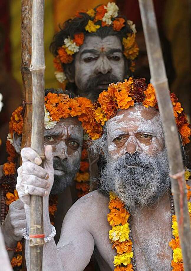 Naga Sadhus, or naked Hindu holy men, sit inside their tent during the Kumbh Mela in Haridwar, India, Tuesday, Feb. 9, 2010. The Kumbh Mela, touted as the largest religious gathering in the world, is celebrated every three years, rotating among four Indian cities. Photo: Rajesh Kumar Singh, AP