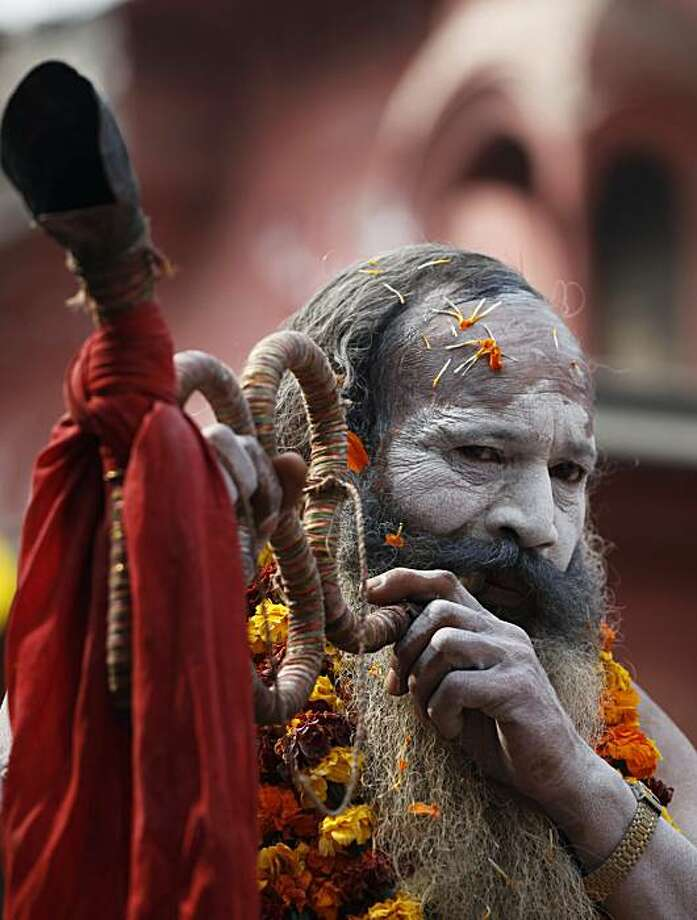 A Hindu holy man participates in a procession during the month long Hindu festival of Kumbh Mela, in Haridwar, India, Sunday, Feb. 7, 2010. The festival, which is celebrated every three years, and rotates among four Indian holy cities is expected to attract more than 10 million people. Photo: Rajesh Kumar Singh, AP