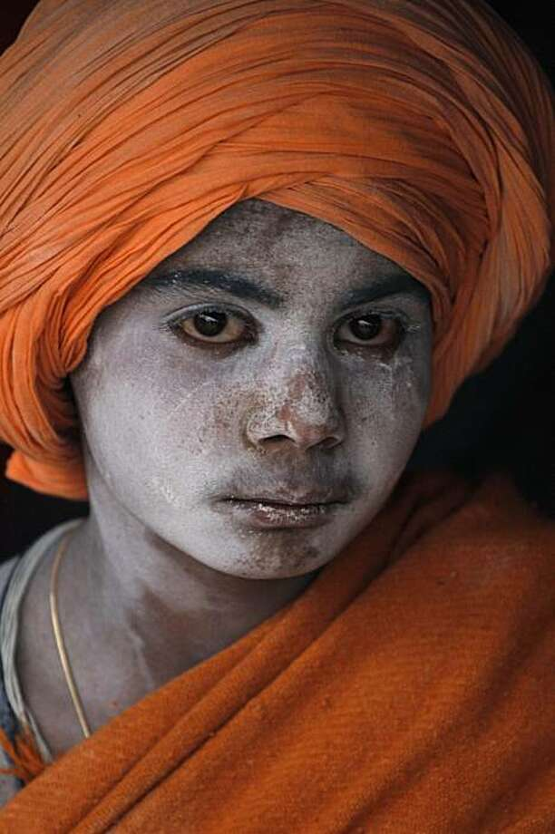 A Hindu holy boy looks on during the month long Hindu festival Kumbh Mela, in Haridwar, India, Monday, Feb. 8, 2010. The festival, which is celebrated every three years, and rotates among four Indian holy cities is expected to attract more than 10 millionpeople. Photo: Rajesh Kumar Singh, AP