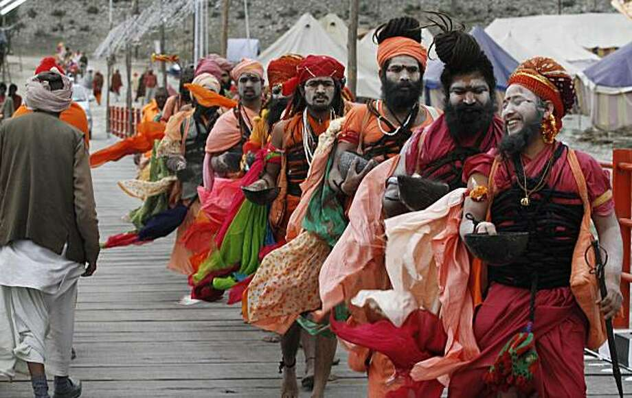 Hindu holy men participate in a procession as they ask for alms called during month long Hindu festival Kumbh Mela, in Haridwar, India, Monday, Feb. 8, 2010. The festival, which is celebrated every three years, and rotates among four Indian holy cities isexpected to attract more than 10 million people. Photo: Rajesh Kumar Singh, AP