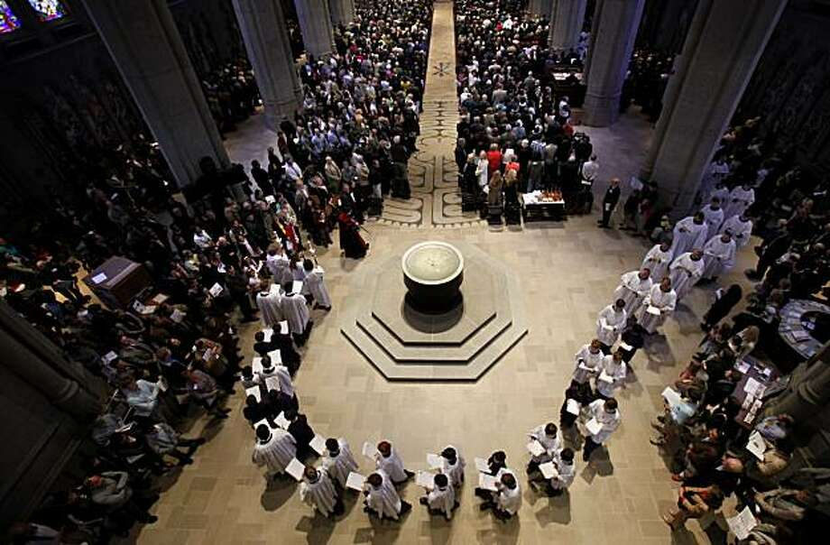 The choir led the Easter Day Procession at Grace Cathedral, followed by clergy and the Episcopal Bishop Rev. Marc Handley Andrus on Sunday in San Francisco. Photo: Brant Ward, The Chronicle